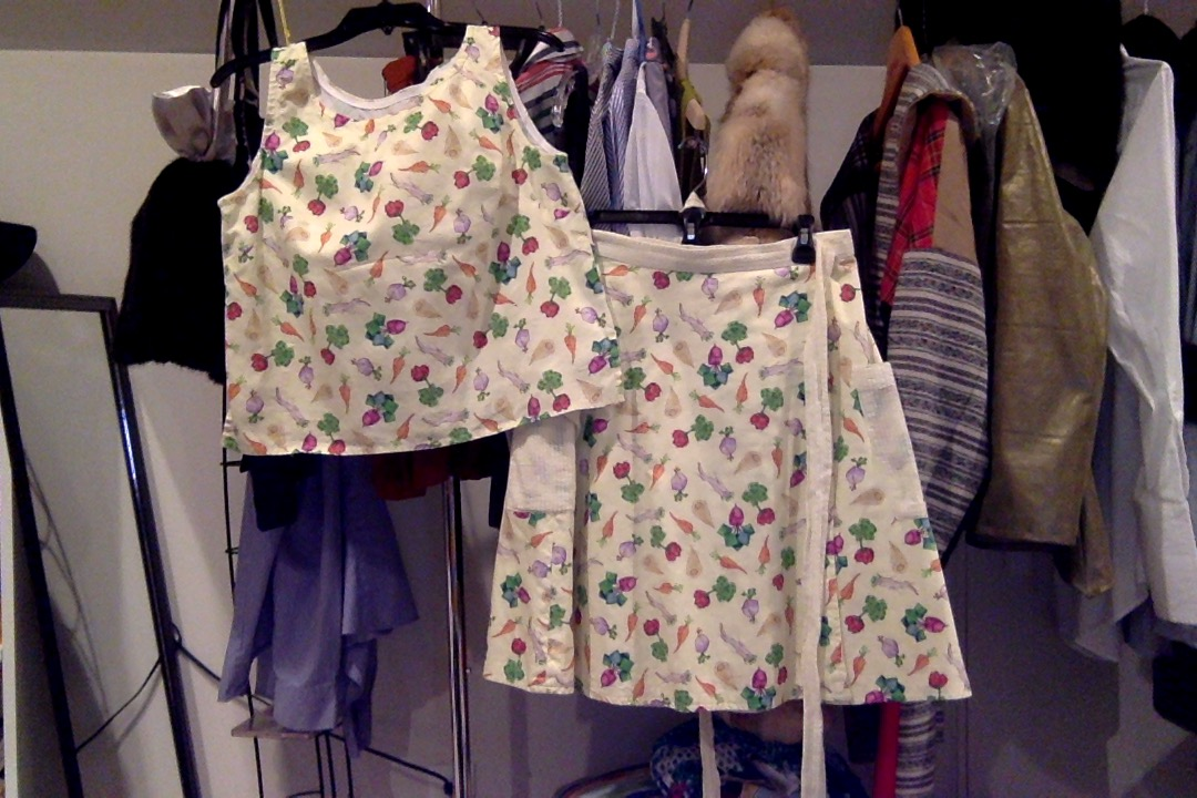 Skirt and shirt made out of fabric that has root vegetables that are in the shapes of rectangular prisms.
